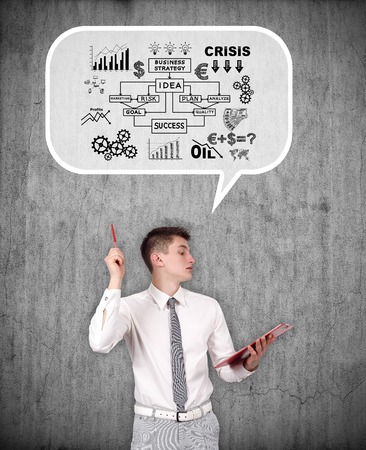 starting a business: young businessman thinking about starting a business Stock Photo