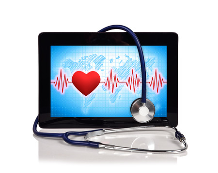 taking pulse: digital tablet with pulse symbol and stethoscope Stock Photo