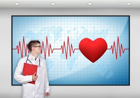 taking pulse: doctor with clipboard looking to screen with pulse symbol Stock Photo