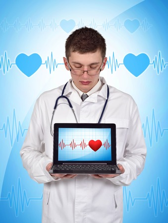taking pulse: young doctor holding laptop with pulse symbol on screen