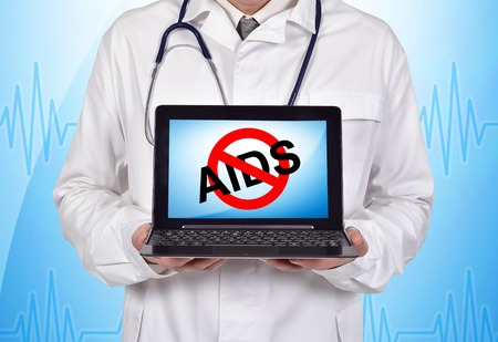 aids symbol: doctor holding notebook with stop aids symbol on screen