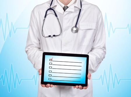 checklist: doctor holding touch pad with checklist on a blue background