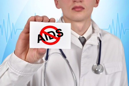 card stop: doctor holding visiting card with stop aids symbol
