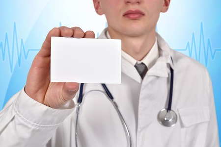 visiting card: doctor with stethoscope holding blank visiting card
