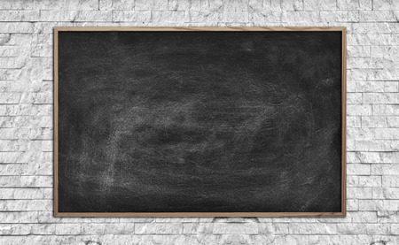 Blackboard with drawing world map on wall in gray room stock photo blank chalk board on brick wall close up photo gumiabroncs Images