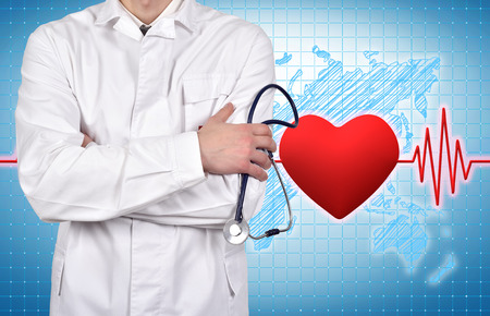 taking pulse: doctor with stethoscope, pulse and heart on background Stock Photo