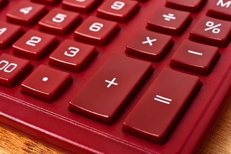 algebra calculator: Red Calculator on table, extra close up Stock Photo