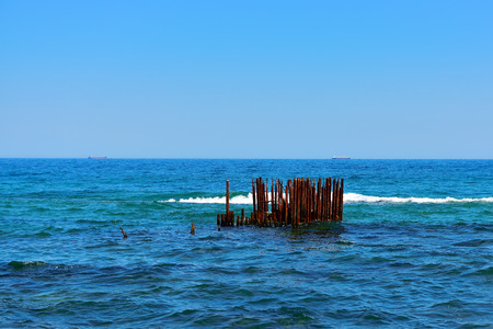 old pier: perfect sky and water of ocean with old pier