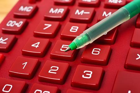 algebra calculator: red calculator with pen, extra close up Stock Photo