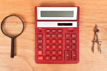 square root: Modern Red Calculator, magnifying glass and compass