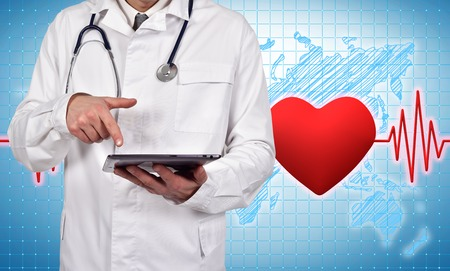 taking pulse: doctor holding digital tablet with pulse and heart on background