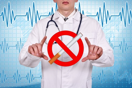 abstain: doctor holding a  no smoking symbol in hand