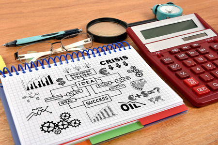 business concept in notebook and red calculator photo