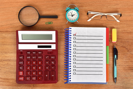 notebook with drawing check box and red calculator photo