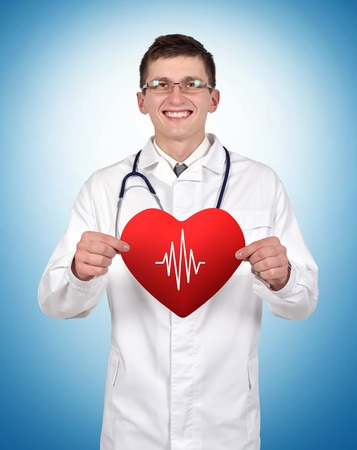 taking pulse: doctor holding heart with pulse on a blue background