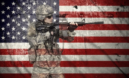 soldier holding rifle on a usa flag background, double exposure
