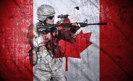 fatigues: soldier holding rifle on a canada flag background, double exposure Stock Photo