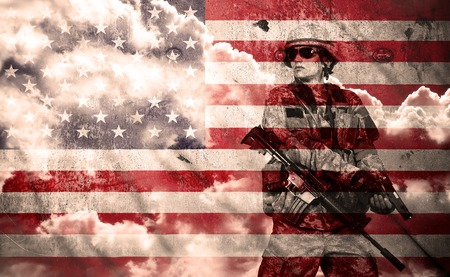 military uniform: soldier with rifle on a usa flag background, double exposure