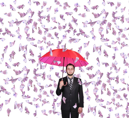 money rain: businessman with umbrella and falling 500 euro banknote Stock Photo