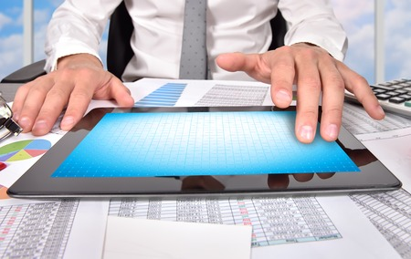 blank tablet: businessman touching blank digital tablet, close up