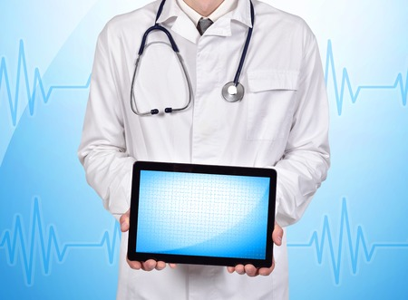 blank tablet: happy doctor holding blank tablet on a blue background