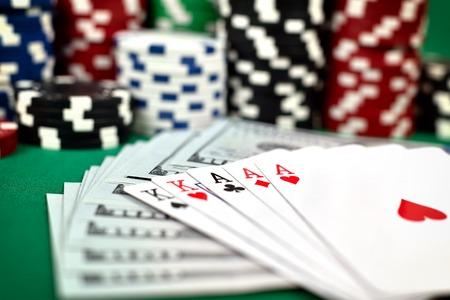 full house: full house, dollars  and poker chips on green table