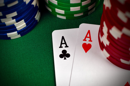 poker: two aces, including spades, hearts, clubs and  poker chips