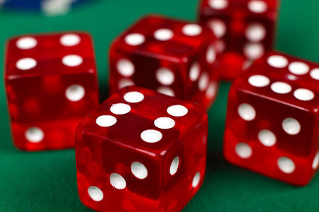 red dice on green table, extra close up