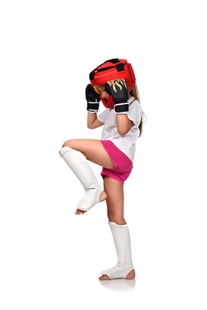 girl fighting: muay thai boxing girl fighting with gloves Stock Photo