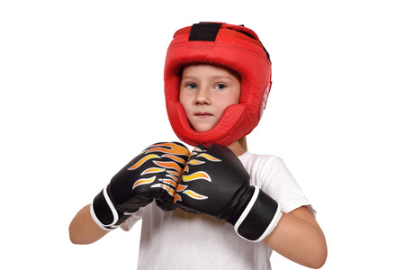 girl punch: muay thai boxing kid in gloves and helmet Stock Photo