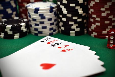 full house: full house and poker chips on green table Stock Photo