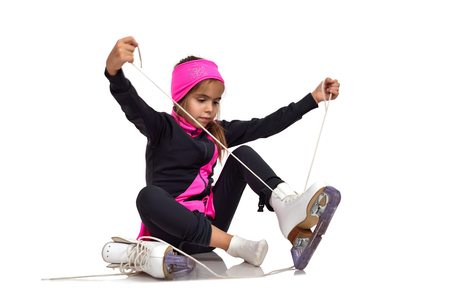 figure skating: young girl figure skating skates laces