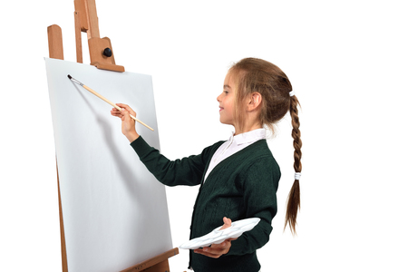 picture person: little girl is painting on blank easel on a white background