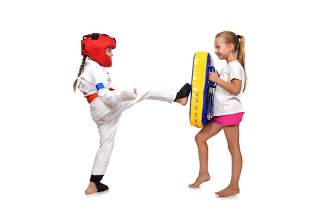 girl fight: karate girl It fulfills kicks  on a white background
