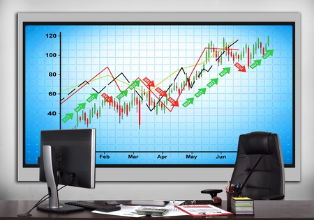big screen: modern office with big screen with stock chart Stock Photo