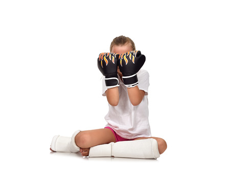 floor covering: girl sitting on floor and covering her face with gloves