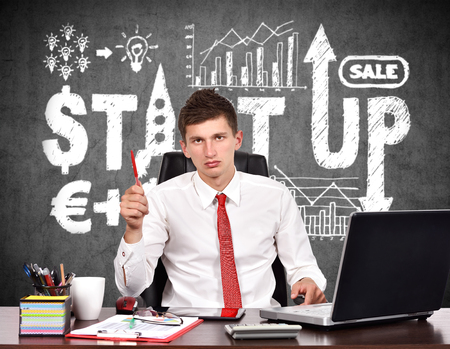 red pen: Businessman with Red Pen Working, start up concept