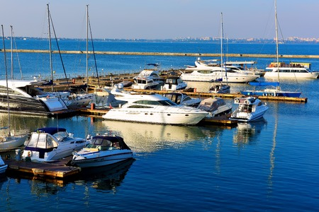 motorboats: yacht and motorboats on blue water, beautiful marina view