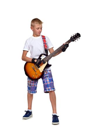 rocker: rocker boy with guitar  on white background