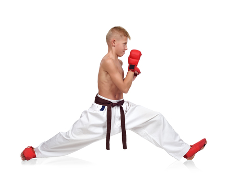 karate boy: Karate boy sits on a twine  isolated on white background