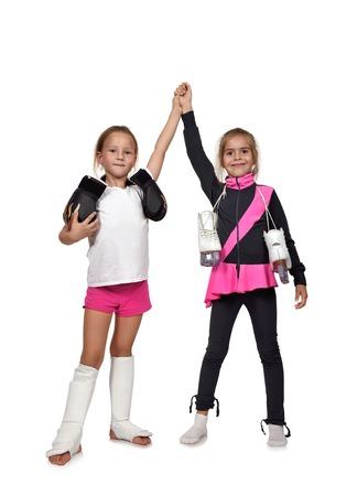figure skating: little girl figure skating and muay thai boxing girl Stock Photo