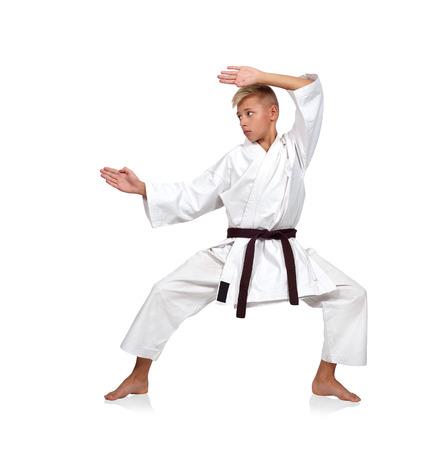 karate boy: karate boy posing isolated on white background Stock Photo