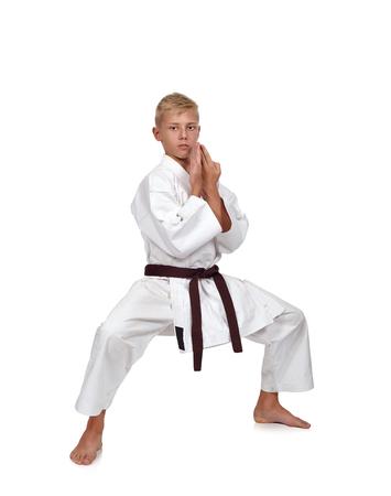 karate boy: karate boy fighting position in white kimono