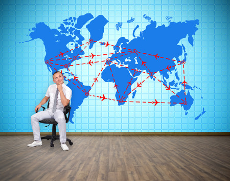 tv wall: businessman and plasma tv wall with air travel plan Stock Photo