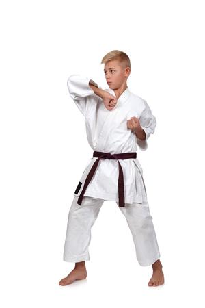 karate boy: Karate boy in kimono fighting on a white background