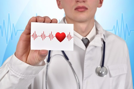 visiting card: doctor holding visiting card with pulse symbol