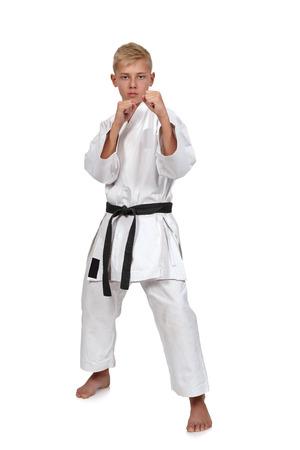 karate boy: karate boy in white kimono with black belt