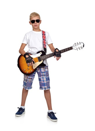 rocker: young rocker boy with guitar  isolated on white background