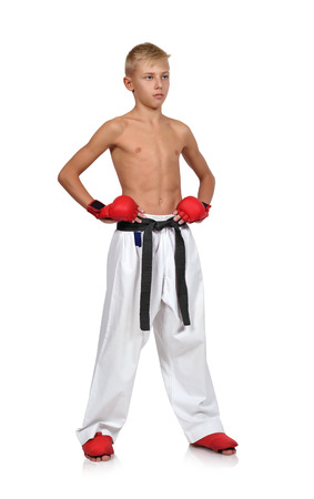 karate boy in red gloves  isolated on white background