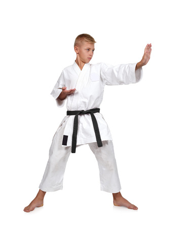 karate fighter: young karate boy isolated on white background Stock Photo